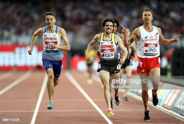 Marcin Lewandowski of Poland crosses the line to win the Men's 1500m ahead of Timo Benitz of Germany and Neil Gourley of Great Britain during day two...