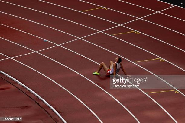 Marcin Lewandowski of Team Poland falls while competing in round one of the Men's 1500m heats on day eleven of the Tokyo 2020 Olympic Games at...