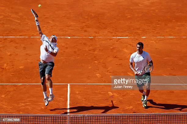 Marcin Matkowski of Poland and Nenad Zimonjic of Serbia in action in their doubles match against Rohan Bopanna of India and Florin Mergea of Romania...