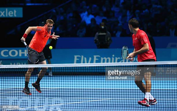 Marcin Matkowski of Poland and Nenad Zimonjic of Serbia in action in their men's doubles match against JeanJulien Rojer of the Netherlands and Horia...
