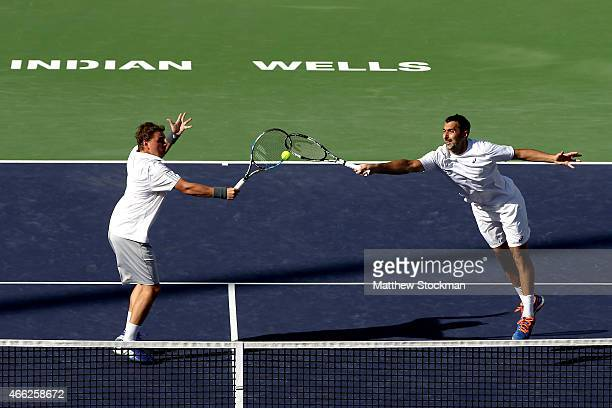 Marcin Matkowski of Poland and Nenad Zimonjic of Serbia play Roger Federer and Michael Lamer of Switzerland during day six of the BNP Paribas Open at...