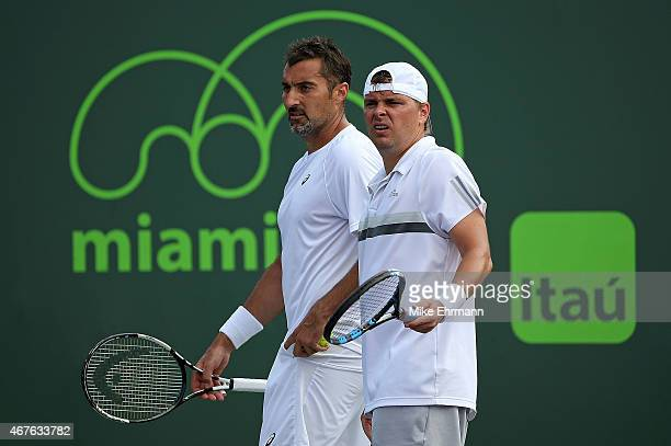 Marcin Matkowski of Poland and Nenad Zimonjic of Serbia talk during a match against Kevin Anderson of South Africa and Jeremy Chardy of France during...