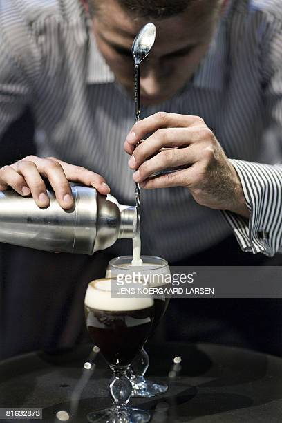 Marcin Michalik from Poland concentrates as he is in the process of making Irish coffee at the World Barista Coffee Championships in Copenhagen on...