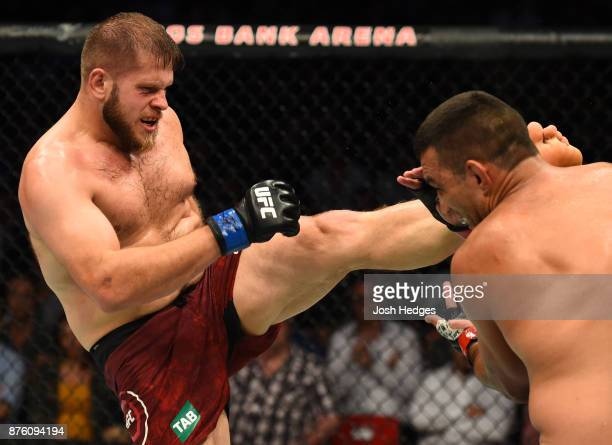 Marcin Tybura of Poland kicks Fabricio Werdum of Brazil in their heavyweight bout during the UFC Fight Night event inside the Qudos Bank Arena on...