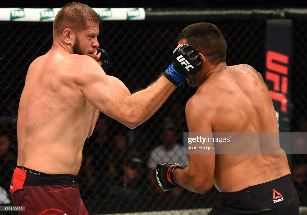 Marcin Tybura of Poland punches Fabricio Werdum of Brazil in their heavyweight bout during the UFC Fight Night event inside the Qudos Bank Arena on November 19, 2017 in Sydney, Australia.