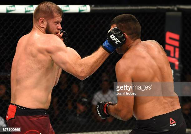 Marcin Tybura of Poland punches Fabricio Werdum of Brazil in their heavyweight bout during the UFC Fight Night event inside the Qudos Bank Arena on...