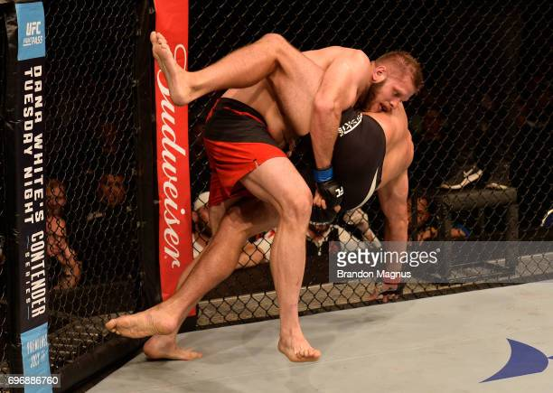 Marcin Tybura of Poland takes down Andrei Arlovski of Belarus in their heavyweight bout during the UFC Fight Night event at the Singapore Indoor...