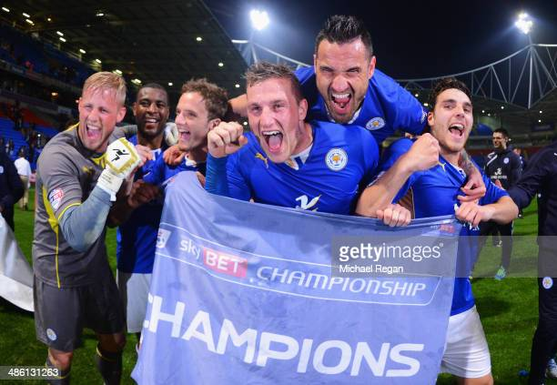 Marcin Wasilewski , Chris Wood and Matty James of Leicester City celebrate winning the Championship with goalkeeper Kasper Schmeichel after the Sky...