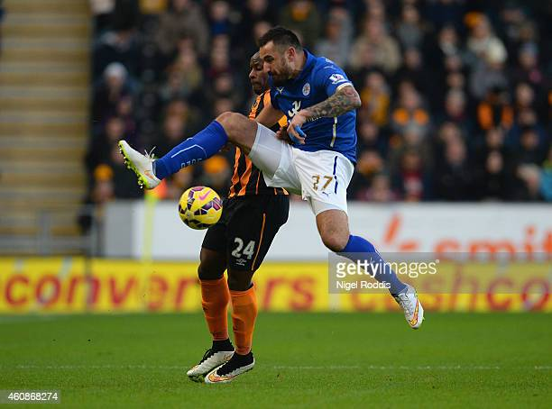 Marcin Wasilewski of Leicester City and Sone Aluko of Hull City battle for the ball during the Barclays Premier League match between Hull City and...