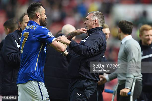 Marcin Wasilewski of Leicester City celebrates with Nigel Pearson manager of Leicester City during the Barclays Premier League match between...