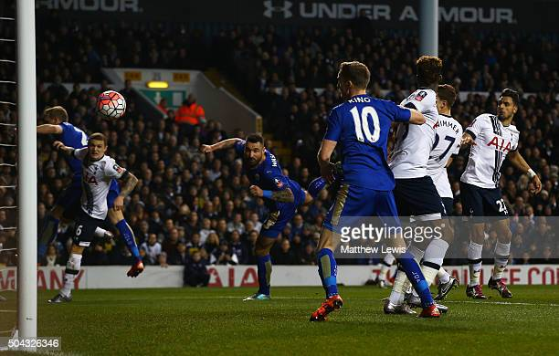 Marcin Wasilewski of Leicester City scores with a header to level the scores at 11 during The Emirates FA Cup third round match between Tottenham...