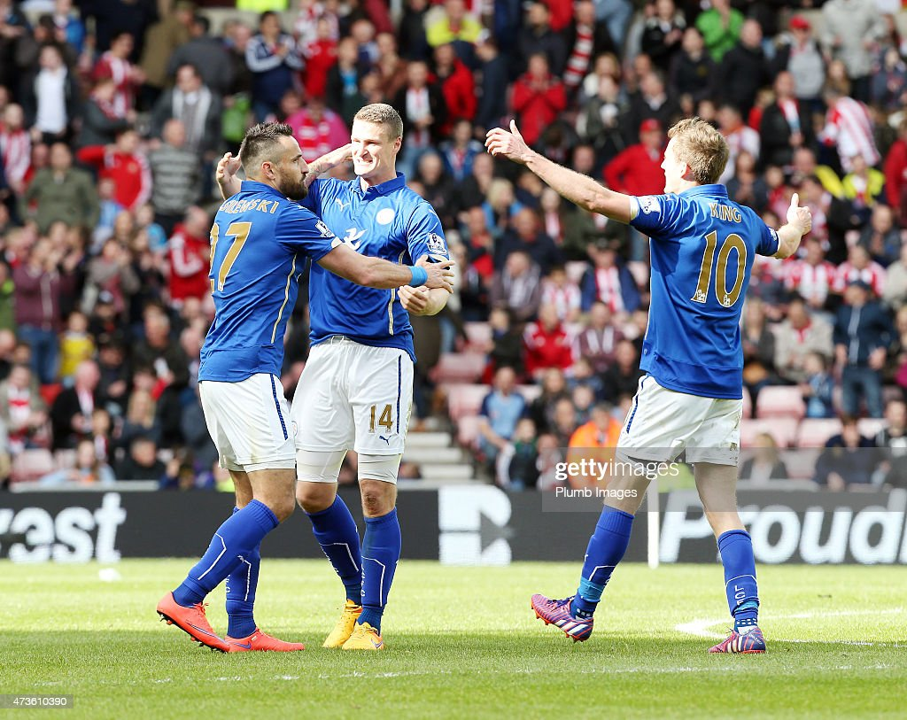 Marcin Wasilewski, Robert Huth and Andy King of Leicester City celebrate after securing their premier league survival after the Premier league match between Sunderland and Leicester City at The Stadium of Light on May 16, 2015 in Sunderland, England.