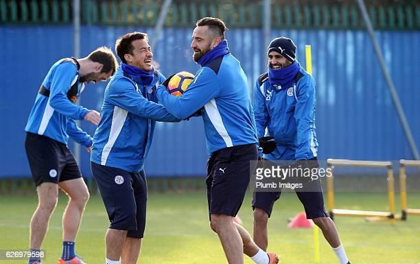 Marcin Wasilewski shares a joke with Shinji Okazaki and Riyad Mahrez during a Leicester City training session at Belvoir Drive Training Complex on...