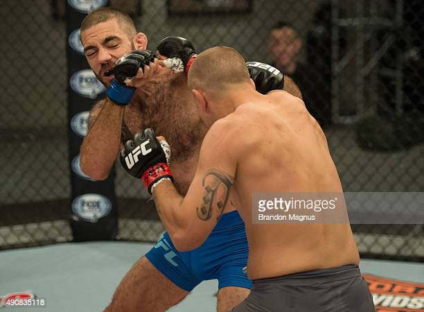 Marcin Wrzosek punches Tom Gallicchio during the filming of The Ultimate Fighter: Team McGregor vs Team Faber at the UFC TUF Gym on July 30, 2015 in...