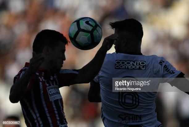 Marcinho of Sao Paulo battles for the ball with Joao Lucas of Ponte Preta during the match between Ponte Preta and Sao Paulo as a part of Campeonato...