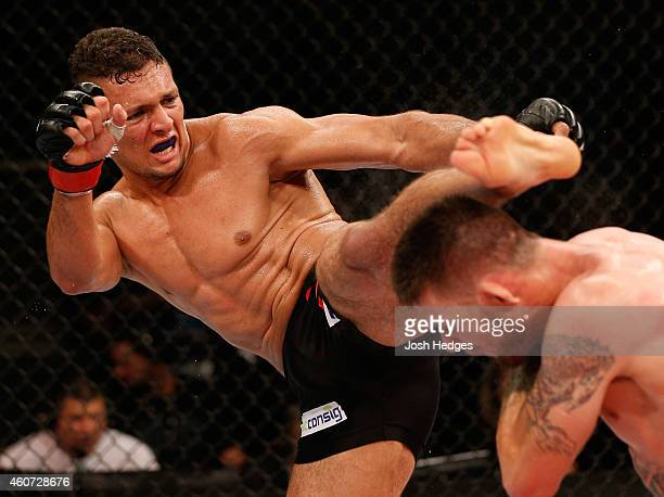 Marcio Alexandre of Brazil kicks Tim Means of the United States in their welterweight fight during the UFC Fight Night event inside the Ginasio Jose...