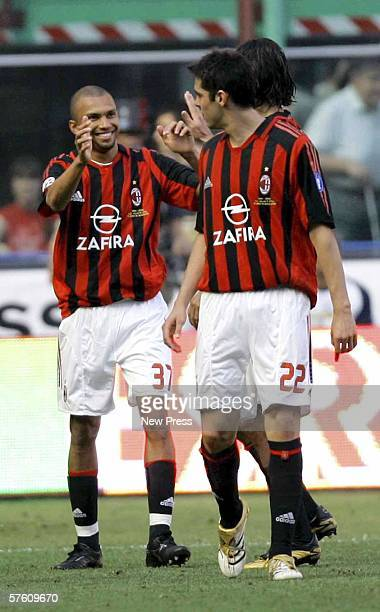 Marcio Amoroso of Milan celebrates with Kaka during the Serie A match between AC Milan and Roma at the San Siro on May 14 2006 in Bari Italy