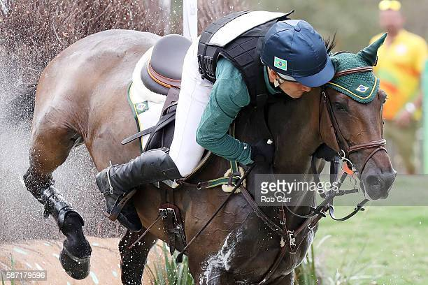 Marcio Appel of Brazil riding Iberon Jmen clears a jump during the Cross Country Eventing on Day 3 of the Rio 2016 Olympic Games at the Olympic...