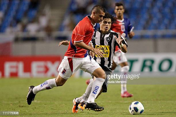 Marcio Azevedo of Botafogo struggles for the ball with Sergio of Parana during a match as part of Brazil Cup 2011 at Engenhao stadium on April 06...