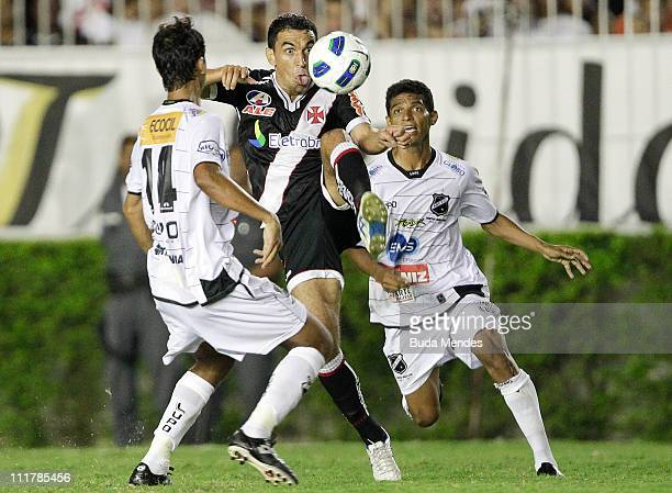Marcio Careca of Vasco struggles for the ball with a players of ABC during a match as part of Brazil Cup 2011 at Sao Januario stadium on April 06,...