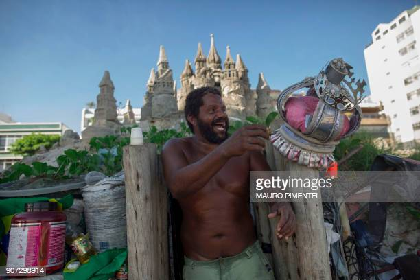 Marcio Mizael Matolias smiles next to his crown and his sand castle in the 40degree heat that punishes bathers on a sunny summer afternoon on the...