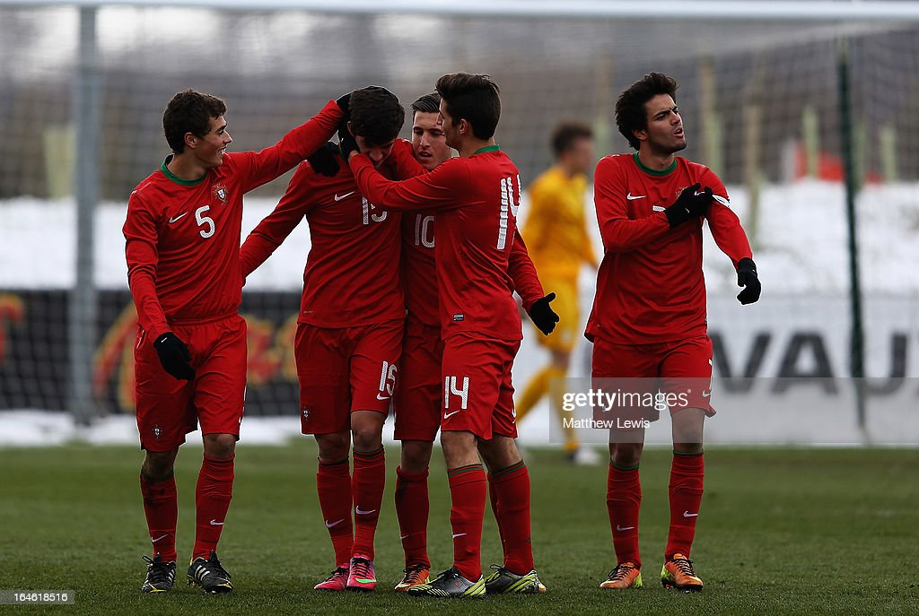 Marcio of Portugal is congratulated on his goal during the UEFA European Under-17 Championship Elite Round match between Slovenia and Portugal at St George's Park on March 25, 2013 in Burton-upon-Trent, England.