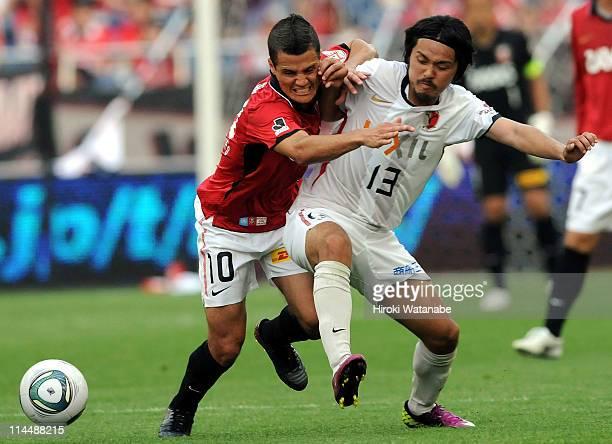 Marcio Richardes of Urawa Red Diamonds and Shinzo Koroki of Kashima Antlers compete for the ball during J.League match between Urawa Red Diamonds and...