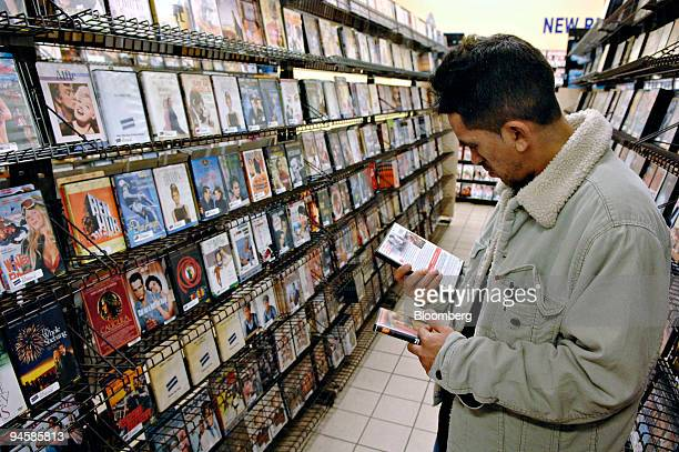 Marco Alvadaro browses DVD's in a Blockbuster store in New York Wednesday November 15 2006