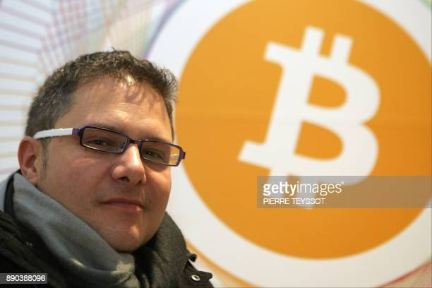 Marco Amadori Ceo of 'inbitcoin' poses in the first Italian Bitcoin crypto currency shop 'Bitcoin Compro Euro' on December 11 2017 in Rovereto...