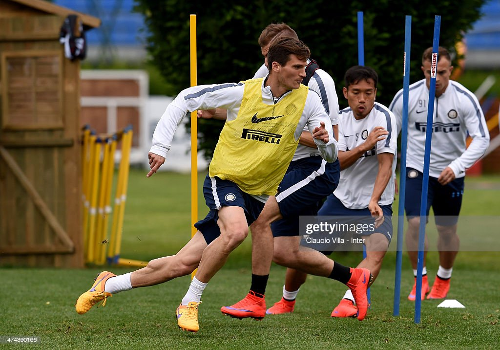 Marco Andreolli (C) in action during FC Internazionale training session at the club's training ground at Appiano Gentile on May 22, 2015 in Como, Italy.