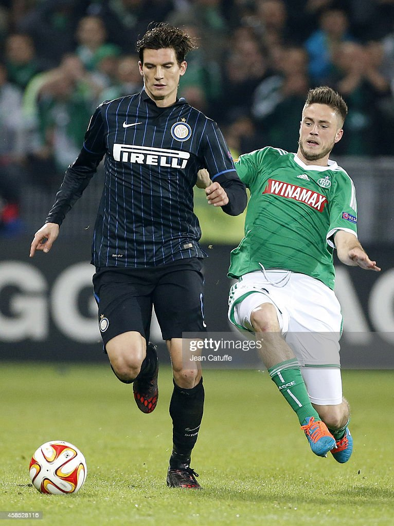 Marco Andreolli of Inter Milan is tackled by Ricky Van Wolfswinkel of Saint-Etienne during the UEFA Europa League Group F match between AS Saint-Etienne and FC Internazionale Milano on November 6, 2014 in Saint-Etienne, France.