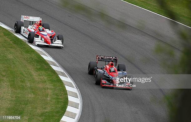 Marco Andretti driver of the Andretti Autosport Dallara Honda and Vitor Meira of Brazil driver of the AJ Foyt Enterprises Dallara Honda drive during...