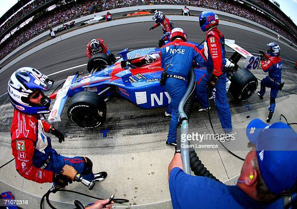 Marco Andretti driver of the ArcaEx Andretti Green Racing Dallara Honda makes a tire and fuel stop during the IRL Indycar Series 90th running of the...