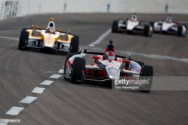 Marco Andretti driver of the RC Cola Andretti Autosport Chevrolet leads the field during the IZOD IndyCar Series Firestone 550 at Texas Motor...