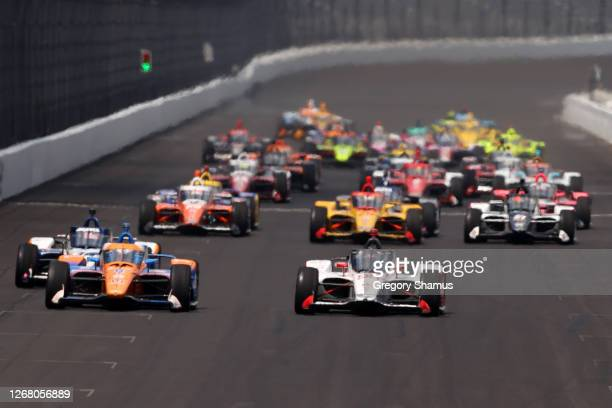 Marco Andretti, driver of the U. S. Concrete / Curb Andretti Herta with Marco & Curb-Agajanian Honda, leads the field during the 104th running of the...
