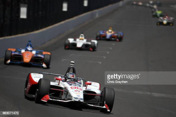 Marco Andretti driver of the US Concrete / Curb Honda leads a pack of cars during the 102nd Running of the Indianapolis 500 at Indianapolis...