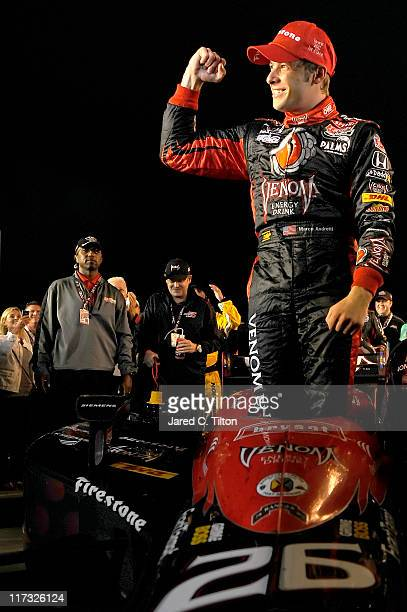 Marco Andretti driver of the Venon Dallara Honda celebrates after winning the running of the Iowa Corn Indy 250 at Iowa Speedway on June 25 2011 in...