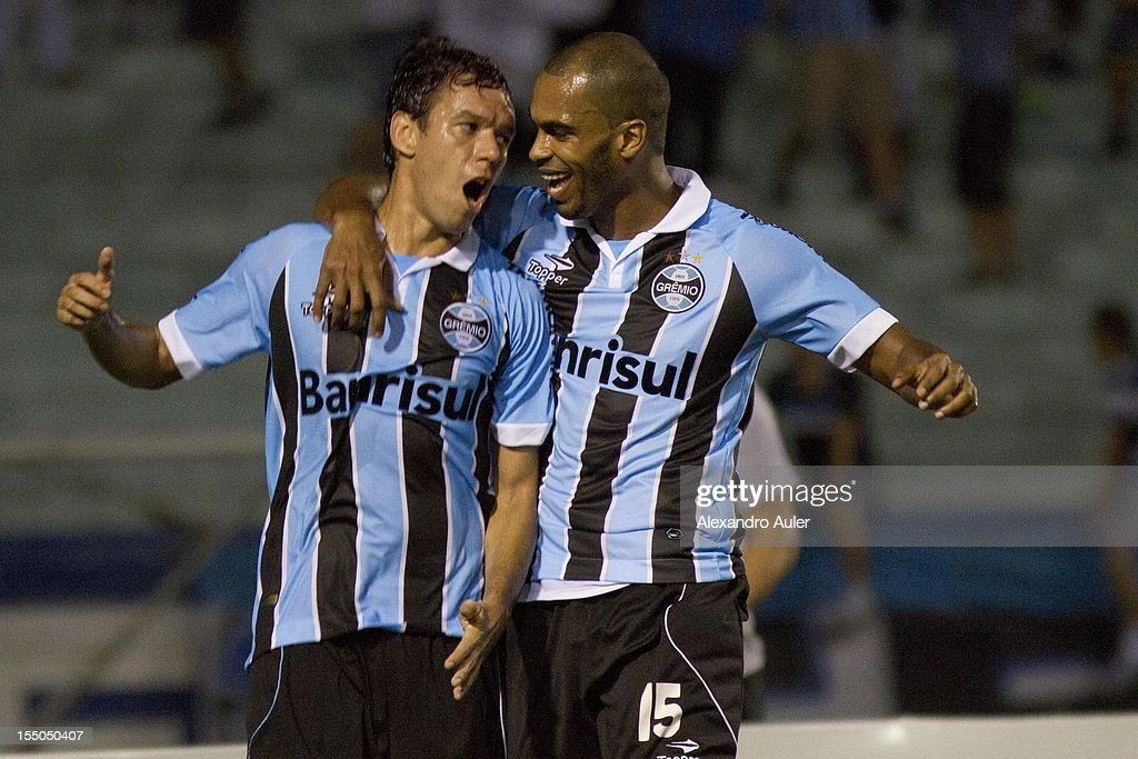 Marco Antonio and Naldo of Grêmio celebrate a goal during the match between Gremio (Brazil) and Millonarios (Colombia) as part of the eighth stage of Copa Sudamericana 2012 at Olímpico stadium on October 30, 2012 in Porto Alegre, Brazil. (Photo by Alexandro Auler/LatinContent/Getty Images).