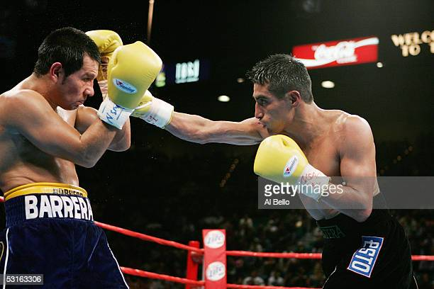 Marco Antonio Barrera blocks the right hand of Erik Morales during the WBC World Super Featherweight Championship at the MGM Grand Garden Arena on...