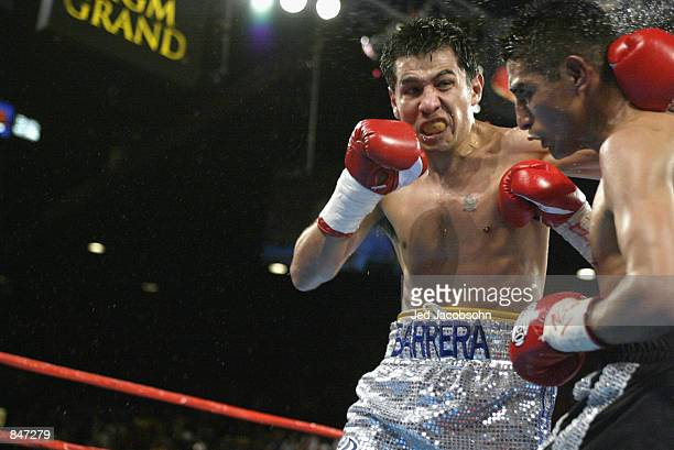 Marco Antonio Barrera hits Erik Morales during the World Featherweight Championship fight at the MGM Grand Hotel/Casino in Las Vegas Nevada on June...