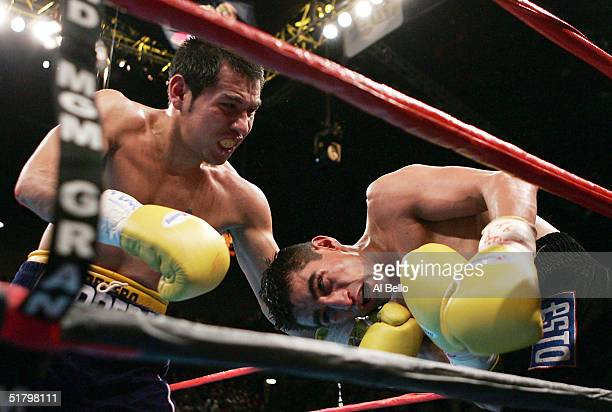 Marco Antonio Barrera keeps Erik Morales against the ropes during a fight for the WBC World Super Featherweight Championship at the MGM Grand Garden...