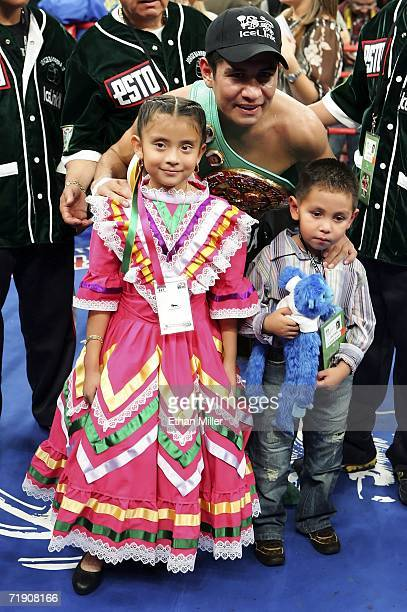 Marco Antonio Barrera of Mexico poses with his kids Jimena and Marco Jr after defeating Ricardo Juarez during their WBC super featherweight titile...