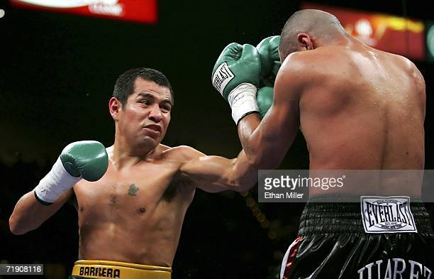 Marco Antonio Barrera of Mexico throws a left and knocks back Ricardo Juarez during their WBC super featherweight titile fight at the MGM Grand...
