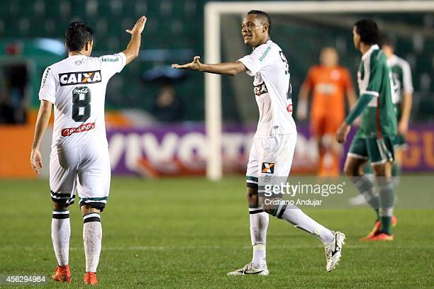 Marco Antonio congratulates Marcao of Figueirense for his goal third of Figueirense during a match between Figueirense and Palmeiras as part of...