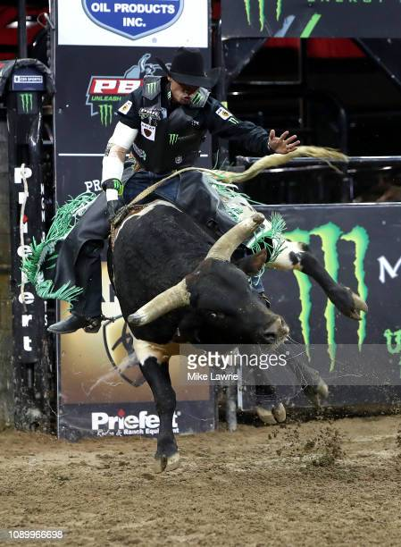 Marco Antonio Eguchi rides BootDaddycom during the PBR Unleash The Beast bull riding event at Madison Square Garden on January 04 2019 in New York...