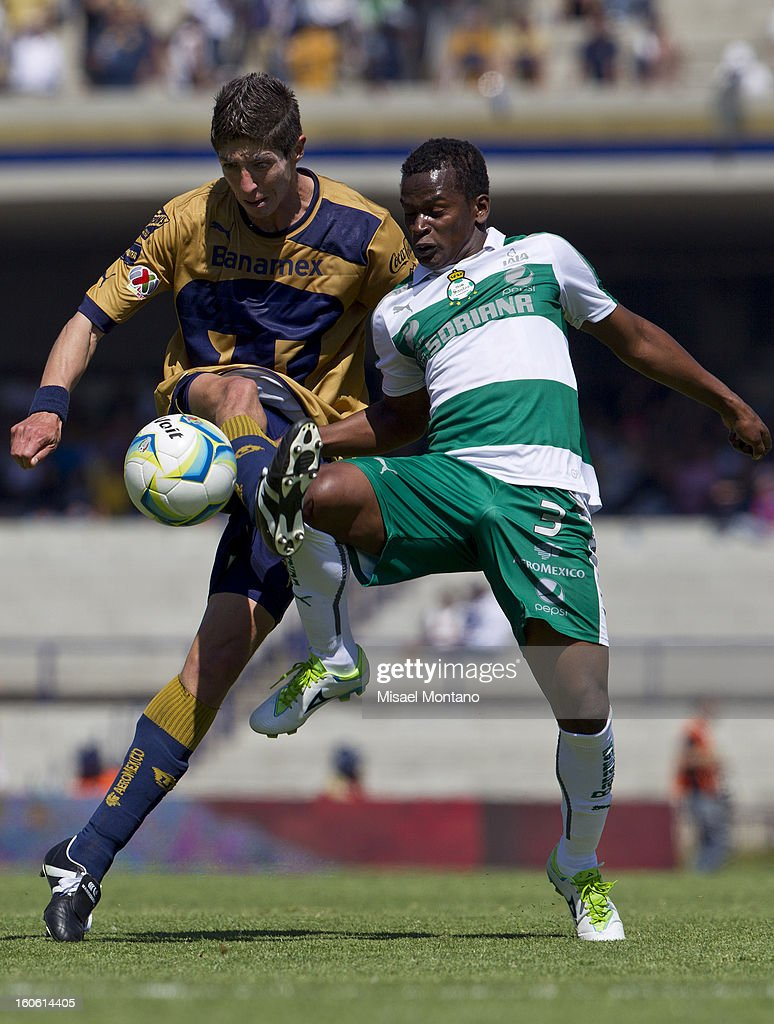 Marco Antonio Palacios of Pumas fights for the ball with Carlos Quintero of Santos during a match between Pumas and Santos as part of the Clausura 2013 at Olímpico Stadium on February 03, 2013 in Mexico City, Mexico.