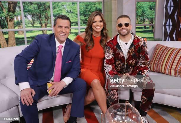 Marco Antonio Regil Rashel Diaz and Nacho on the new set of Un Nuevo Dia at Telemundo Center on May 21 2018 in Doral Florida
