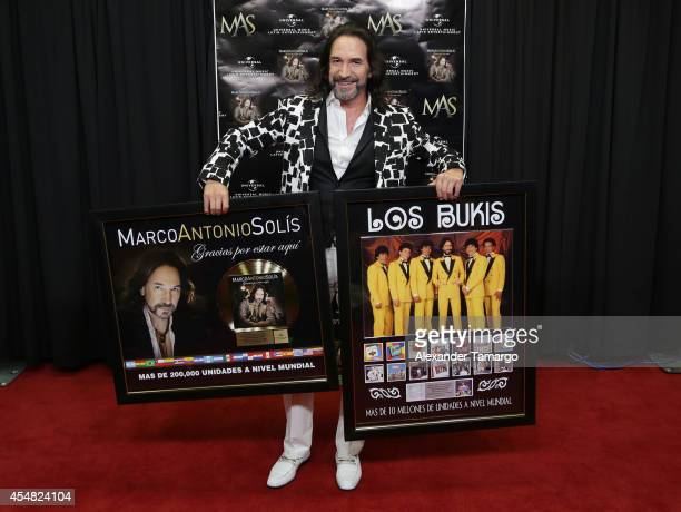 Marco Antonio Solis accepts two awards backstage at American Airlines Arena on September 6, 2014 in Miami, Florida.