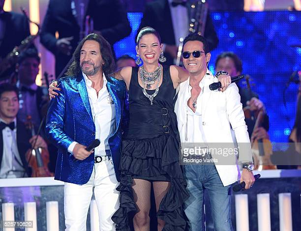 Marco Antonio Solis, Natalia Jimenez and Marc Anthony perform onstage at the Billboard Latin Music Awards at Bank United Center on April 28, 2016 in...