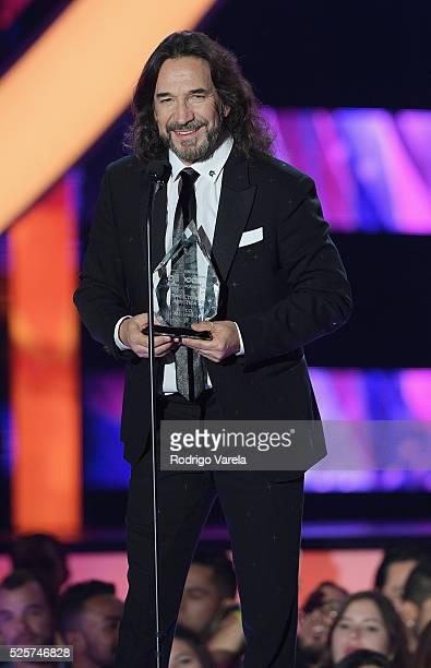 Marco Antonio Solis recieves award onstage at the Billboard Latin Music Awards at Bank United Center on April 28, 2016 in Miami, Florida.
